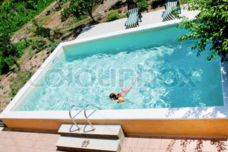 Open air swimming pool in country house yard stock photo - An open air swimming pool crossword clue ...