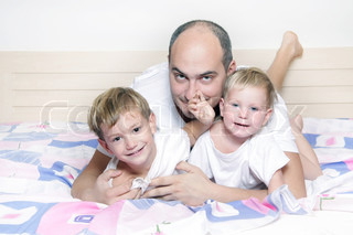 father and two children at home