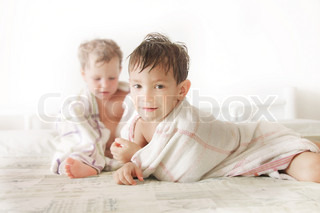 two kids in bed after shower
