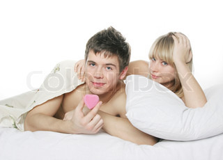 young couple with valentine gift in bed