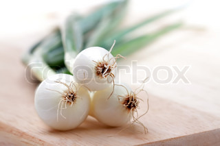 Three bulbs spring onions on white background