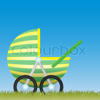 Baby Carriage on the meadow with the blue sky behind