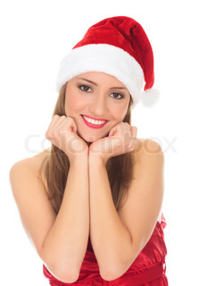 Picture of pretty christmas girl in red dress and santa hat, smiling isolated on white background