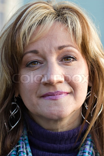 A pretty middle aged woman with a very sincere smile Shallow depth of field