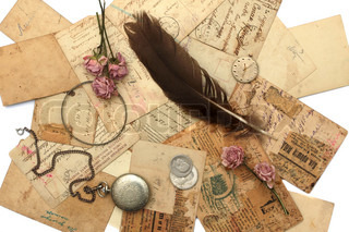 Vintage background with old watch, postcards, photographs and flowers
