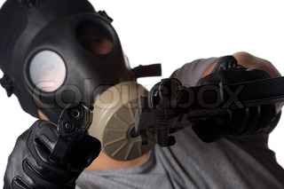 A man wearing a gas mask pointing two guns at the viewer Shallow depth of fieldWorks great for crime or warfare concepts