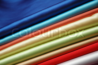 Stack of satin fabric of various colours