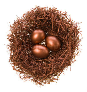 Three eggs in a nest of bronze colour on a white background