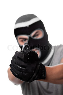 An angry looking man aiming a handgun at the viewer Works great for crime or home security concepts