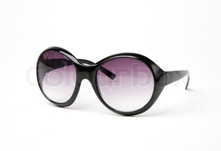 Female sun glasses in a black frame and lilac lenses on a white background close up