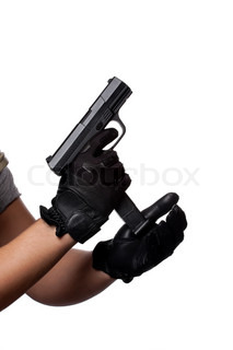 A man loading or unloading a clip into a black handgun isolated over whiteWorks great for crime or home security concepts