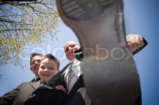 A groomsman in a wedding party decides to stomp on the photographerThis could be used for a variety of concepts