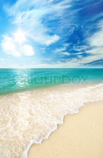 beach sand and sky with clouds on sea