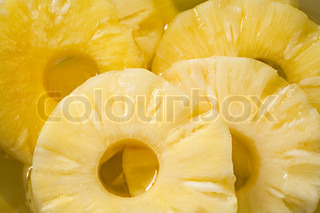 Pineapple compote with circles of pineapple close up