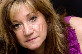 Portrait of a serious looking middle aged woman
