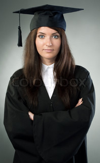 young beauty graduate woman on gray background