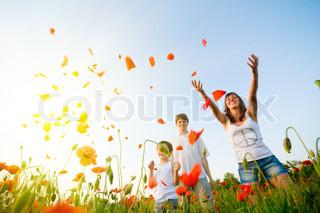family in red poppy field