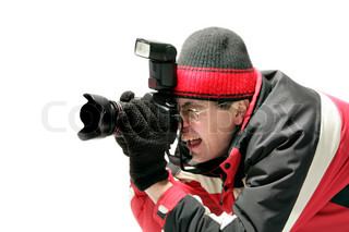 Professional photographer taking a shot isolated over white background