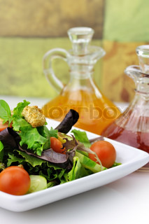 fresh vegetable salad with salad dressings