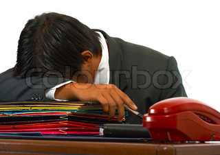 Overloaded Worker Having A Nap On His Desk