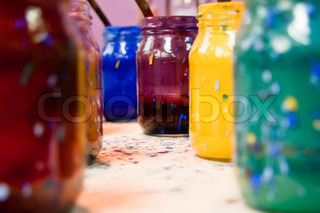 Glass jars containing dyes of various colors used for the crafts painting