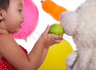 Kid Having Fun Feeding Her Teddy An Apple