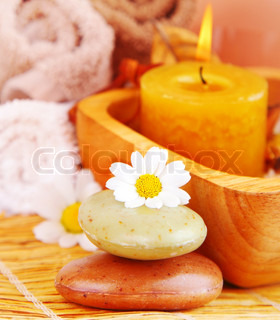 Spa candle and organic herbal soap with daisy flowers, zen relaxation concept