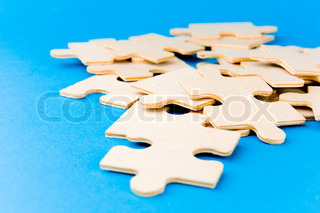 Puzzle pieces on blue background for Peculiarity crossword clue