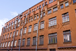 Old Industrial building from red bricks with metal rain pipes, Saint Petersburg, Russia