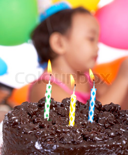 Chocolate Cake And Party Balloons For A 3 Year Old