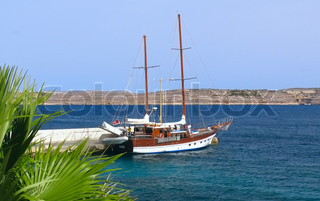 Sailing boat yacht in Mediterranean sea near the coast of Malta