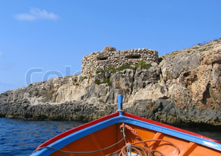 View to old fortification from the boat near famous Blue Grotto on Malta island