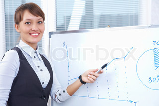 young businesswoman drawing graph on chart in office