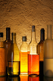 Lots bottles of alcohol drinks over textured background