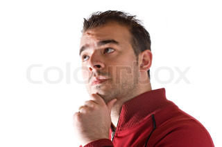 A young man thinking about something deeply with his hand on his chin