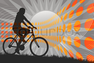 A silhouette of a person riding a bike in front of the sun