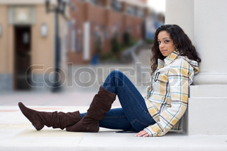 A young Indian woman posing outdoors in an urban setting Shallow depth of field