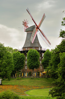 This photograph represent the historic windmill from Wallenlange park in Bremen, Germany This beautiful photograph is perfect for your travel brochure and any other info about Bremen or Germany