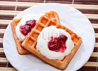 dessert with soft waffle and raspberry jam