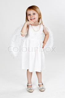 little girl with wings on a gray background