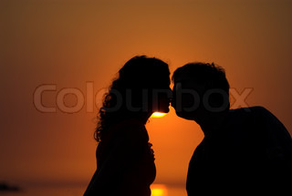 Young couple is kissing on the beach