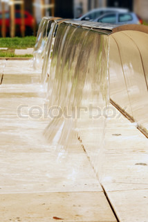 modern fountain with falling water in Budapest, Hungary