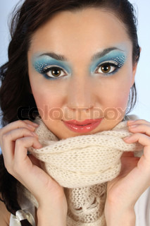 close up portrait of beautiful woman with winter blue make-up
