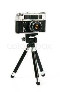 Kamera auf Stativ isoliert auf weiß