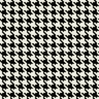 A black and white seamless hounds tooth pattern or texture with lots of detail