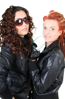 Two glamorous woman in leather jackets and sunglasses