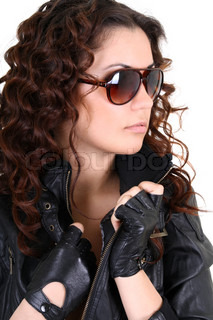 Glamorouse brunette woman in leather jacket and sunglasses