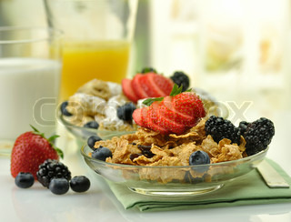 cereal with fruits ,milk and juice
