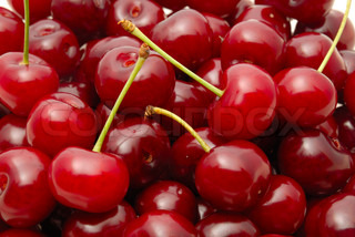 Background from a red cherry with green fruit steams