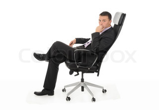Businessman sitting in a chair in a bright office Isolated on white background